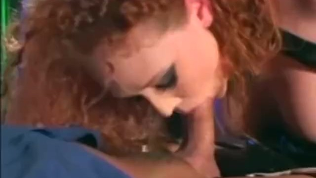 Xaviera hollander and nude Audrey hollander in a cop uniform and latex molesting a guy