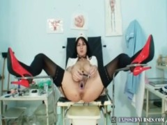 Nurse Adriana stretching pussy wide with a speculum