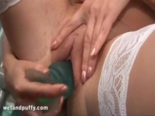 Asia Carrera's plays with her dildo