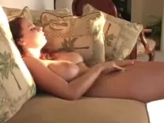Busty amateur playing with her snatch