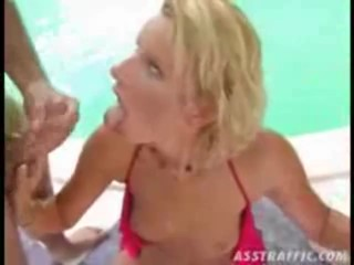 Two dudes stick their dicks in both of this cute girls holes