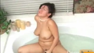 Asian MILF toys herself in the bath dildo cocktease milf masturbation wet asian big tits solo boobs water tease pussy butsy bath toy
