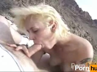 Blonde bitch tries to give a good blowjob outdoor