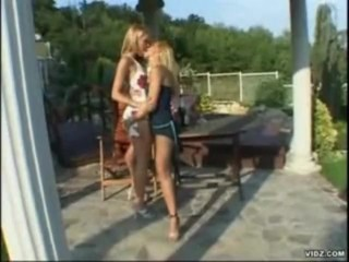 Blonde lesbos play outside with toys