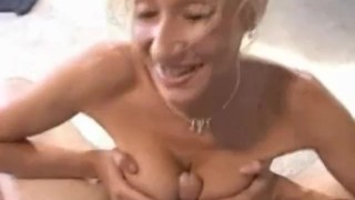Blonde bombshell gives a titfuck and BJ