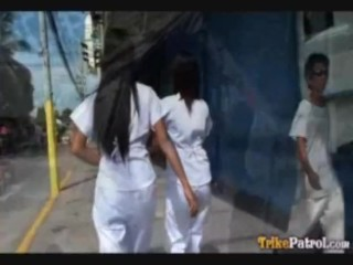 Two Filipina nurses take special care of patient