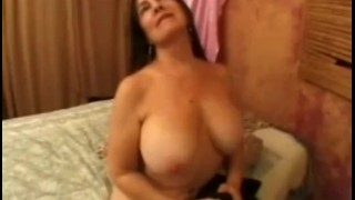 Busty Mature Giving Head