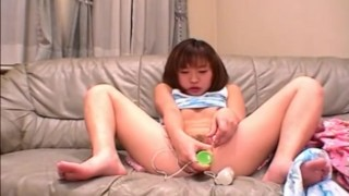 Solo Asian slut drilling a cucumber in her hole
