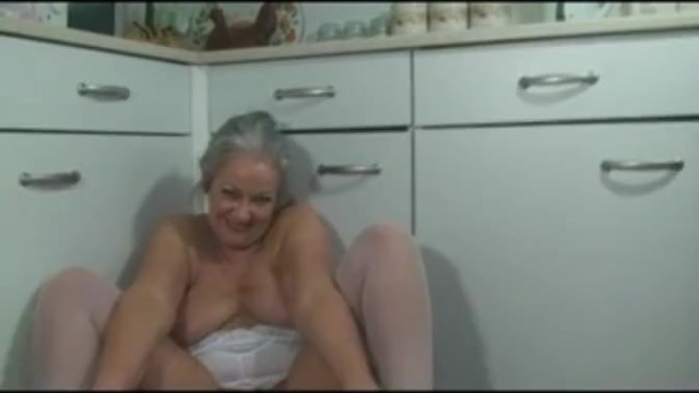 Mature ladies in Mature ladies fucks her pussy in the kitchen