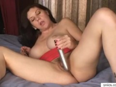 Busty mom loves toys in hairy pussy