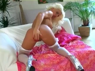 Big boobed milf in panties and stockings plays with her pussy