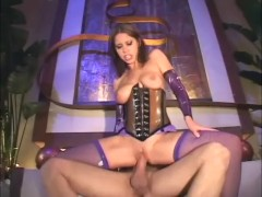 Sexy brunette getting pounded in a shiny corset and fishnet stockings