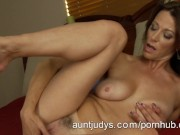 Milf Mimi Moore masturbates on her bed