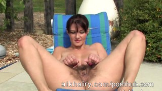 Busty hairy Vanessa gets naked at the pool