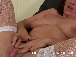 Hot Milf masturbates in fish net stockings
