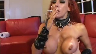 Wearing heavy makeup she sucks big cock