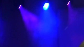 Busty stripper on the stage teasing and dildoing pussy