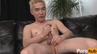 Blonde asian tugs at his cock porno
