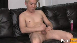 Blonde asian tugs at his cock Piercing big