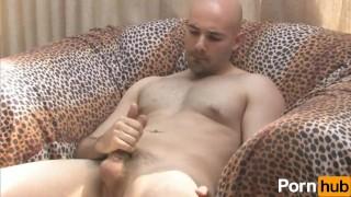 Solo bald guy masturbates on couch Cumming manicured