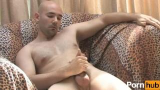 Solo bald guy masturbates on couch