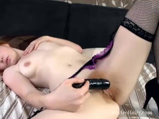 Hairy Florence shoves a dildo in her hairy red pussy