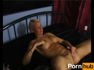 Skinny blonde cougar masturbates and cums