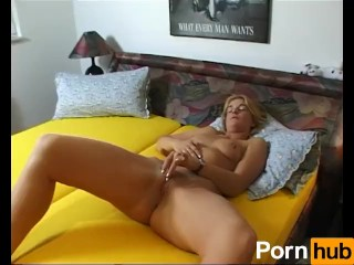 Blonde beauty masturbates with big dildo