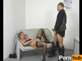 Mature woman masturbates on the couch