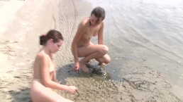 Nudist girls have fun with each other at the beach