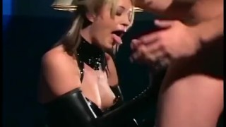 Sexy blonde in uniform and latex gloves fucking on a desk