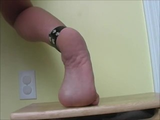 Sexy feet pose beautiful arches and soles