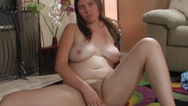 Hairy Lindsay plays with her wet pussy hairs on floor