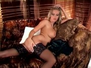 Busty blonde rubbing her pussy in thigh high stockings and high heels