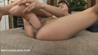 Girl stripping and masturbating hard with a big beige brutal dildo in HD