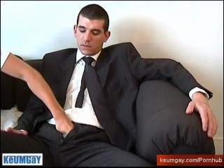 A straight suite trousers guy get wanked his huge cock by a guy !