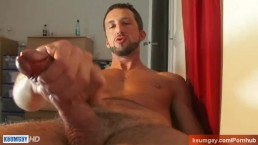 A very sexy italian hunk get wanked his huge cock in spite of him !