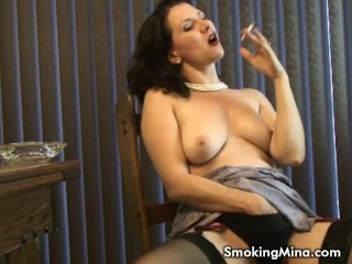 Sexy MILF puffs on a cigarette