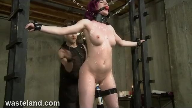 Sex whip and chain - Redhead submissive chained to rack, whipped, waxed and made to cum hard