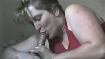 Beautiful milf oils Up His cock and Takes A load On her face