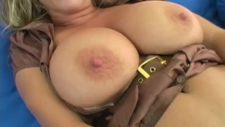 Amber uses a big dildo while rubber her huge natural tits