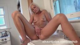 Hot blonde cougar Elizabeth masturbates in the kitchen