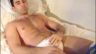 Estebano, a very sexy spanish guy get wanked his huge cock by us !