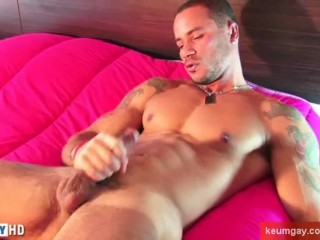 Sport guy serviced this latino guy get wanked his huge cock by a guy