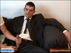 A straight guy in suite trouser gets wanked his huge cock by a gay guy !