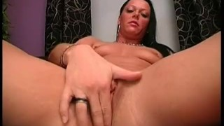 Carmen stretches her tight pussy with a humongous dildo