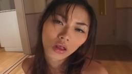 Luscious Japanese babe Mai Kuramoto wanks a stiff cock uncensored
