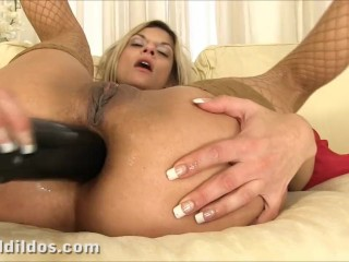Blonde babe slamming a big black brutal dildo deep in her asshole
