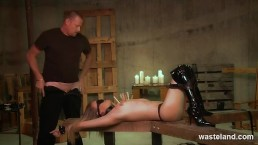 Female sex slave in knee high boots blindfolded with cock stuffed