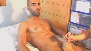 Str8 Middle-east guy gets wanked his big cock by a guy in spite of him.